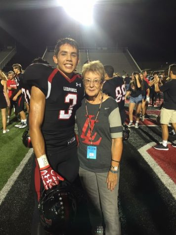 After a home win against Frisco Wakeland, Jane takes a photo with senior safety Blake Pfaff.