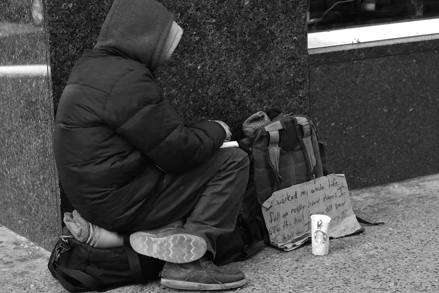 A homeless man in Times Square in New York braces the cold for donations and spare change. Columnist Lily Hager writes about the importance of helping the disadvantaged and unfortunate.