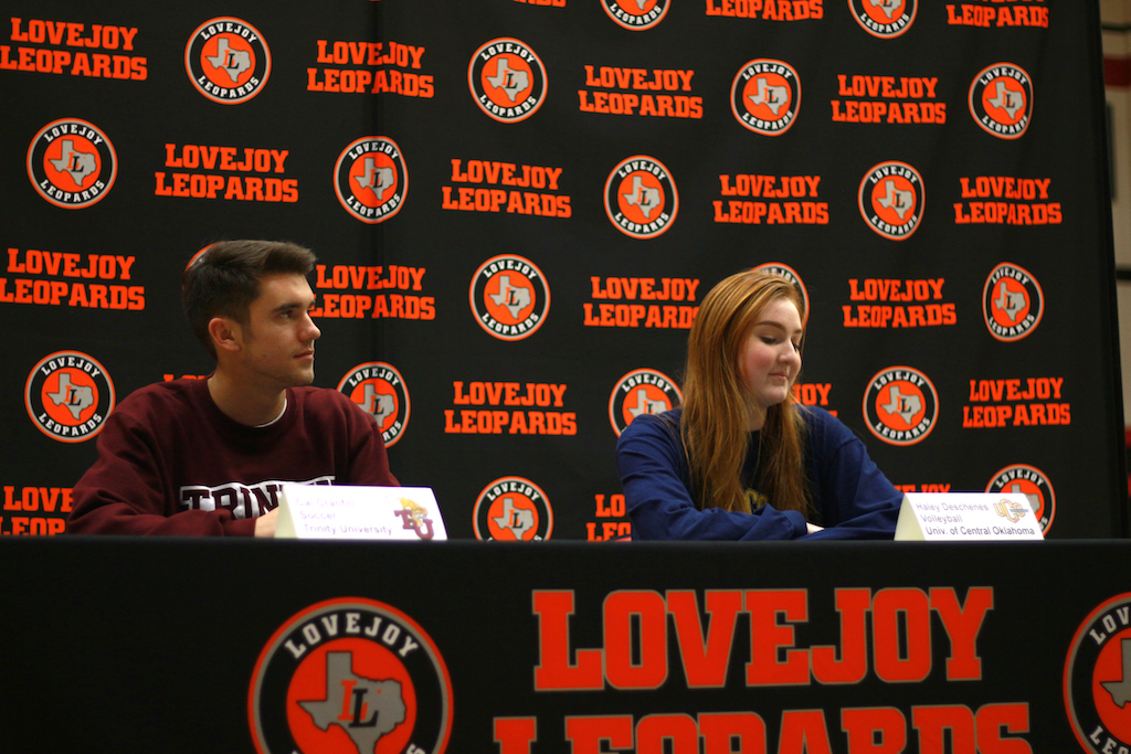 Seniors Cal Cranfill (left) and Haley Deschenes sit at Lovejoy's new signing stage.
