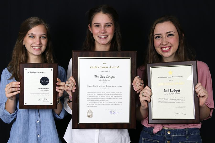 Seniors+and+editors-in-chief+Jillian+Sanders%2C+Hallie+Fischer%2C+and+Caroline+Smith+hold+up+the+NSPA+Pacemaker+Finalist%2C+CSPA+Gold+Crown%2C+ILPC+Gold+Star+awards.