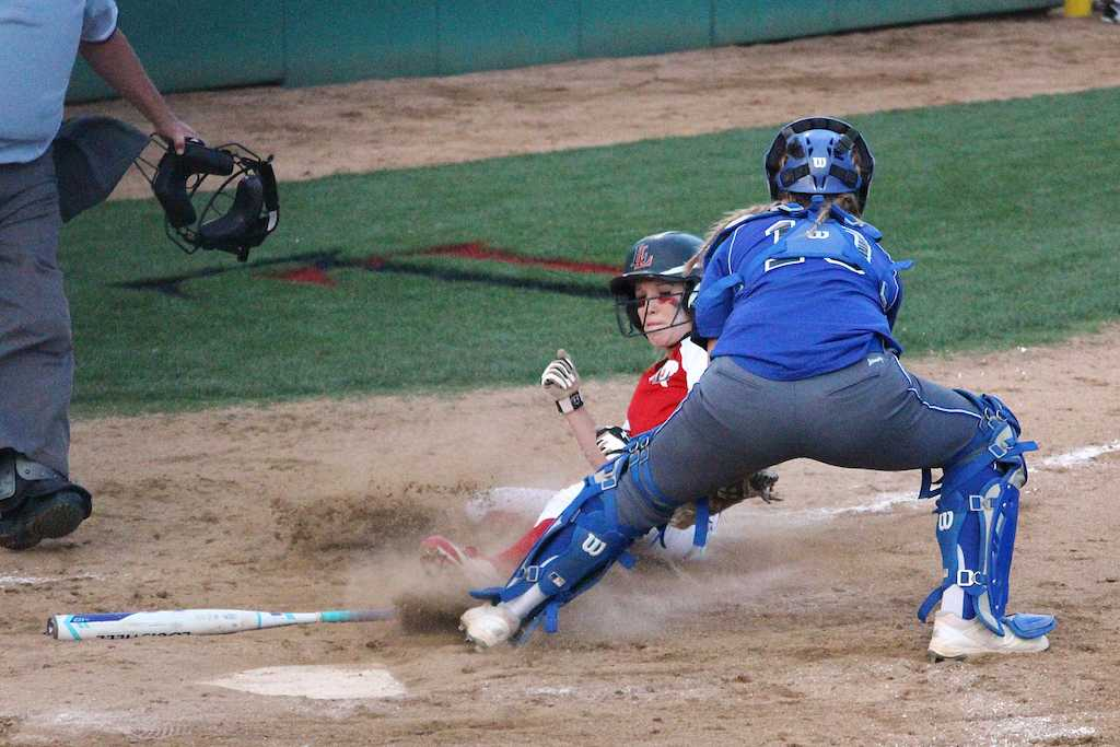 Senior Alex Bellows sliding home during 3rd inning.