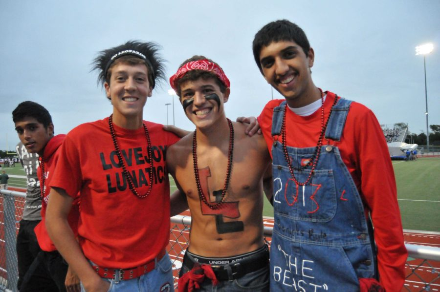 Seniors Austin Welhouse, Kyle Berger, and Arun Sethi lead the student section in spirit during the Friday night football games.