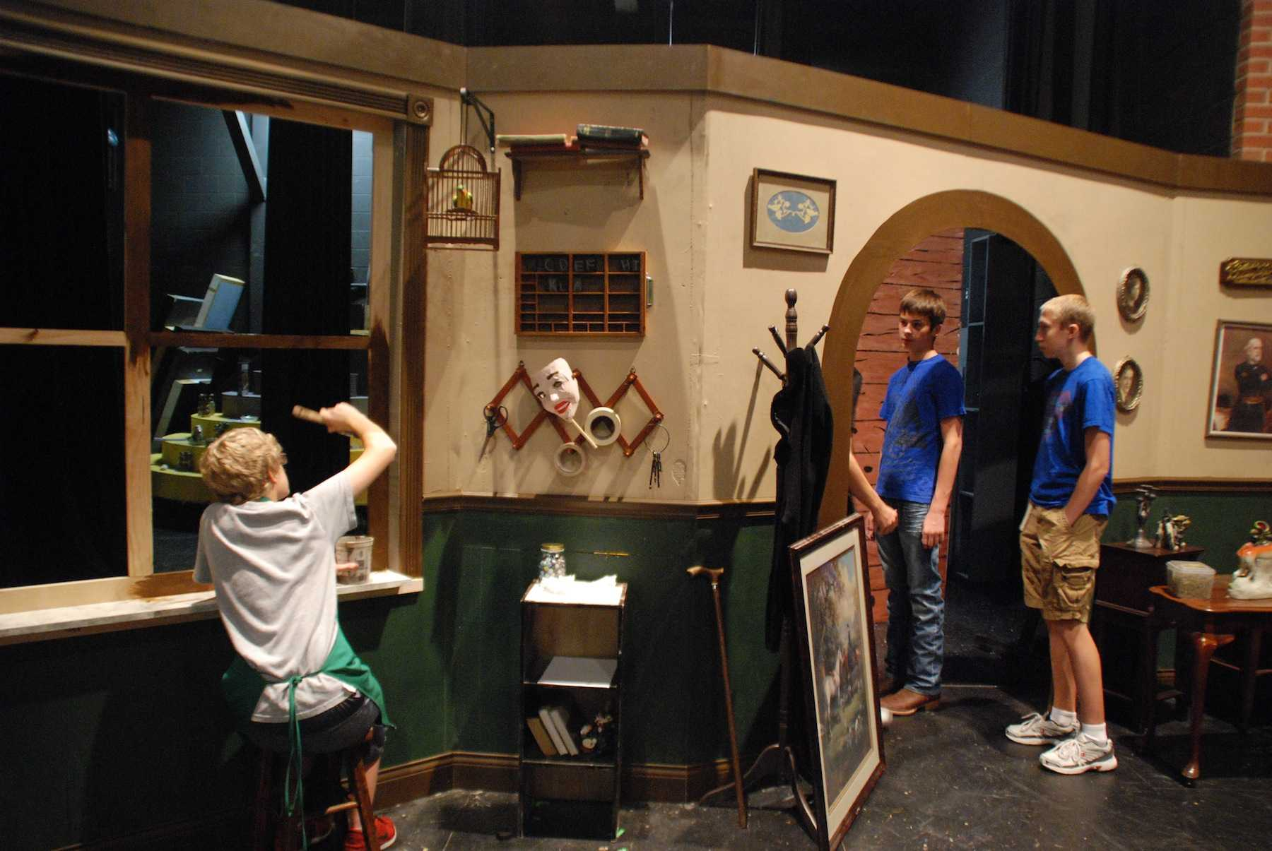 First period theater students help finalize the set for the theatre program's fall production