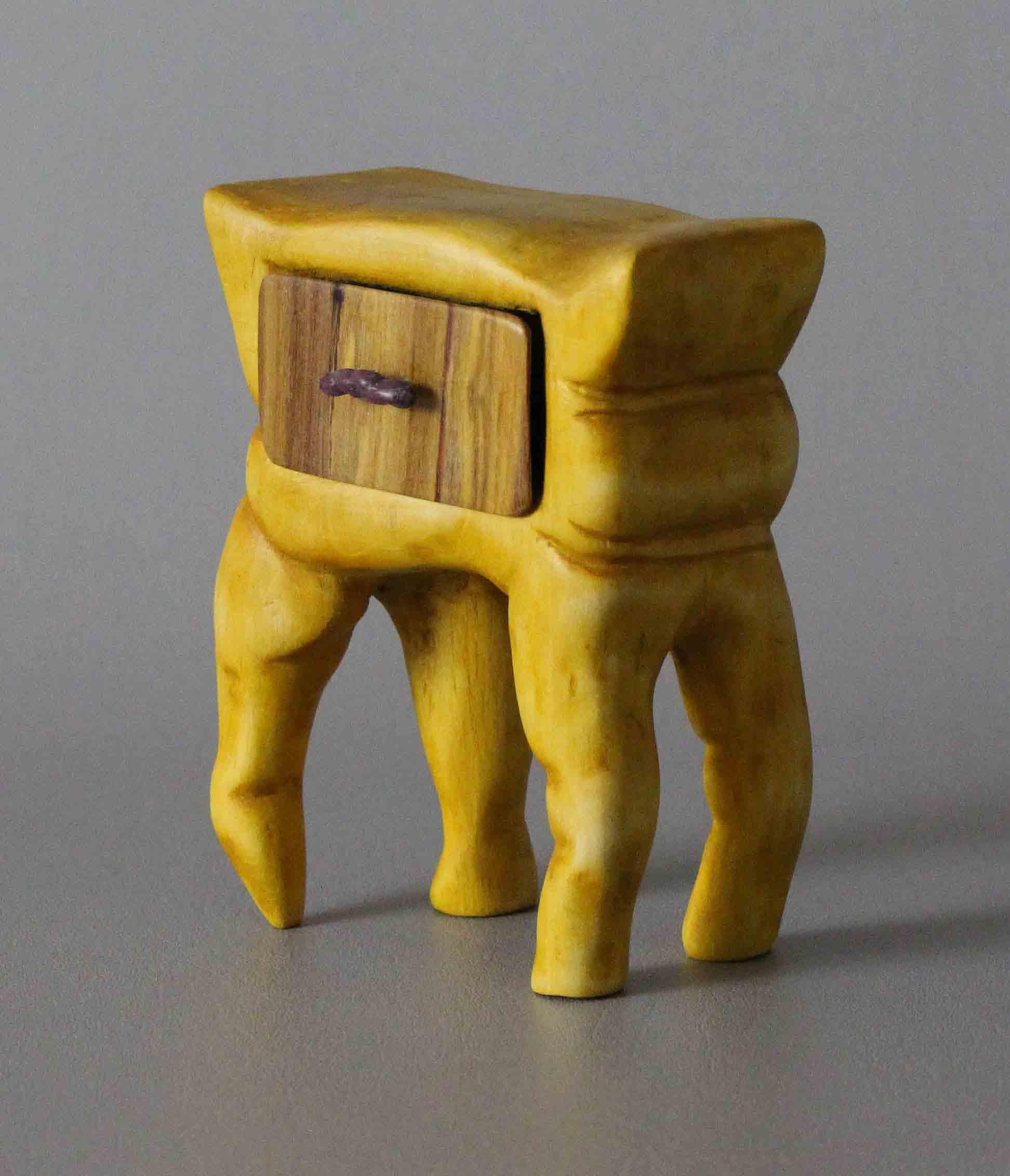Grant Woodruff's wood carving titled Beyond Creep.