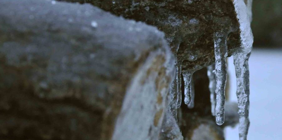 Wood+piles+left+out+overnight+now+have+hard+layers+of+ice+and+icicles+embedded+into+the+tops+of+the+wood.