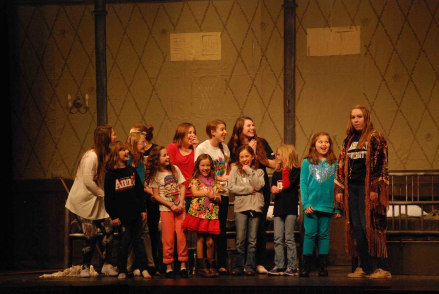 Elementary+school+girls+and+older+are+participating+as+cast+in+Annie.