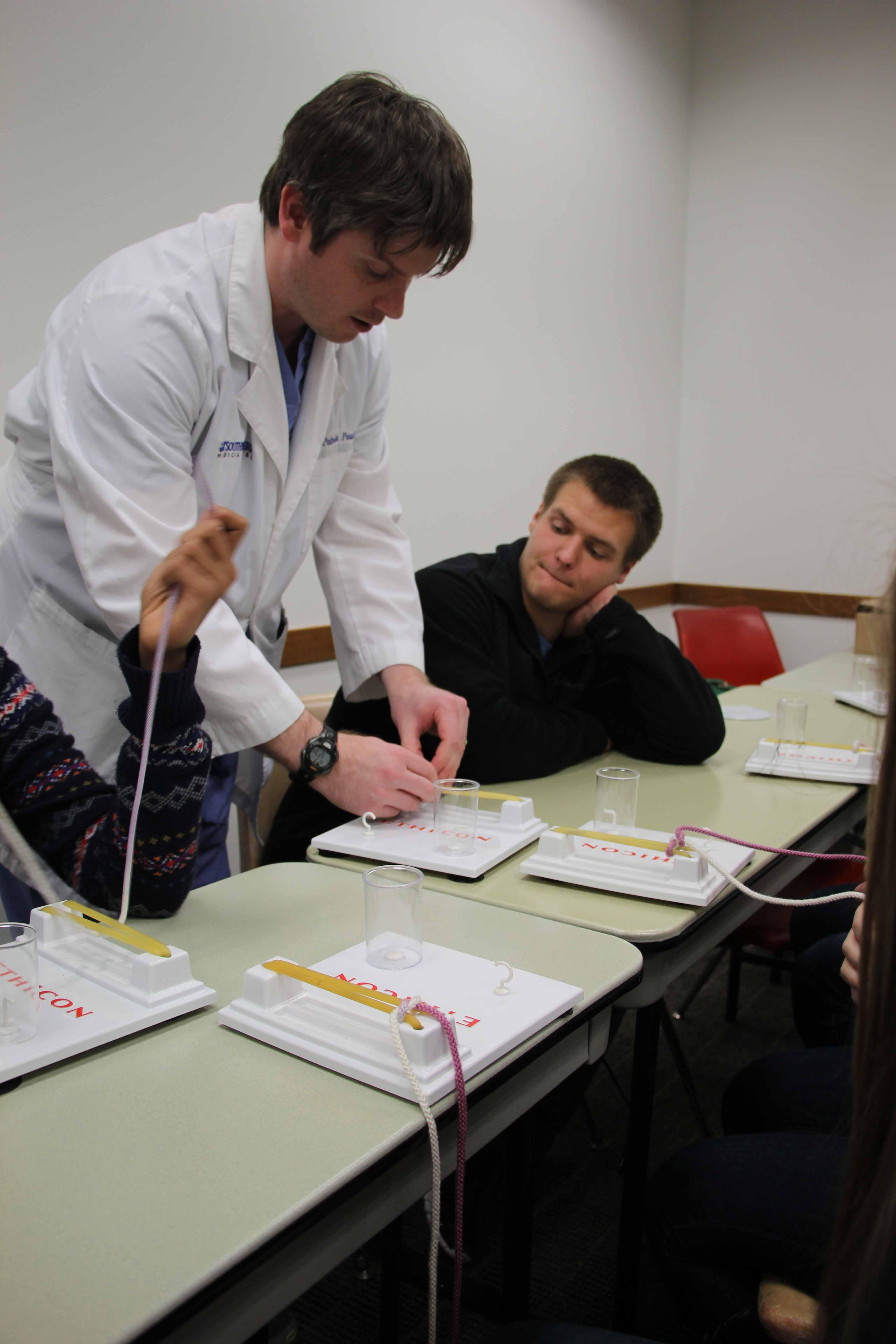 Students studying health science received help and instruction from medical professionals, like senior Jacob Poteet.