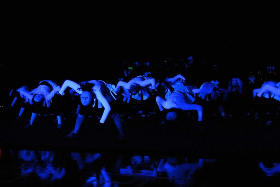 The cheerleaders performed a routine with masks for the 2011 black-light pep rally. The routine was enhanced by the black-light effects.