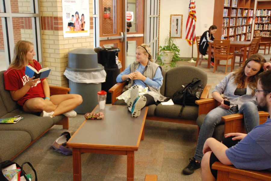 The library is a popular hangout spot for seniors to relax when they are not in class or when they have nothing else to do.