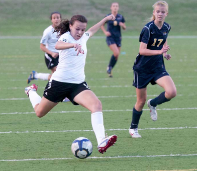 Junior Dominique Mazero dribbles in last year's playoof match aganist Highland Park, this year, they are working to win district.