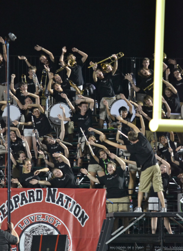 Senior+Michael+Pezzuli+leads+the+band+in+their+roller+coaster+game+as+one+of+three+drum+majors+of+the+band.