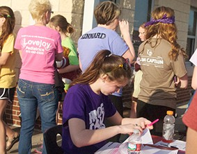 Students and staff work at the front booth of Relay for Life in 2014. The third annual Relay for Life is Friday, March 27 from 7 p.m. to 7 a.m.