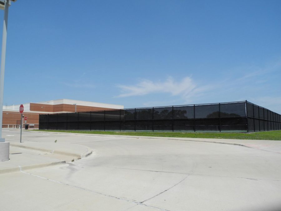 One of the proposed locations for the district's new swimming pool is at Sloan Creek Intermediate School where the tennis courts are currently located.