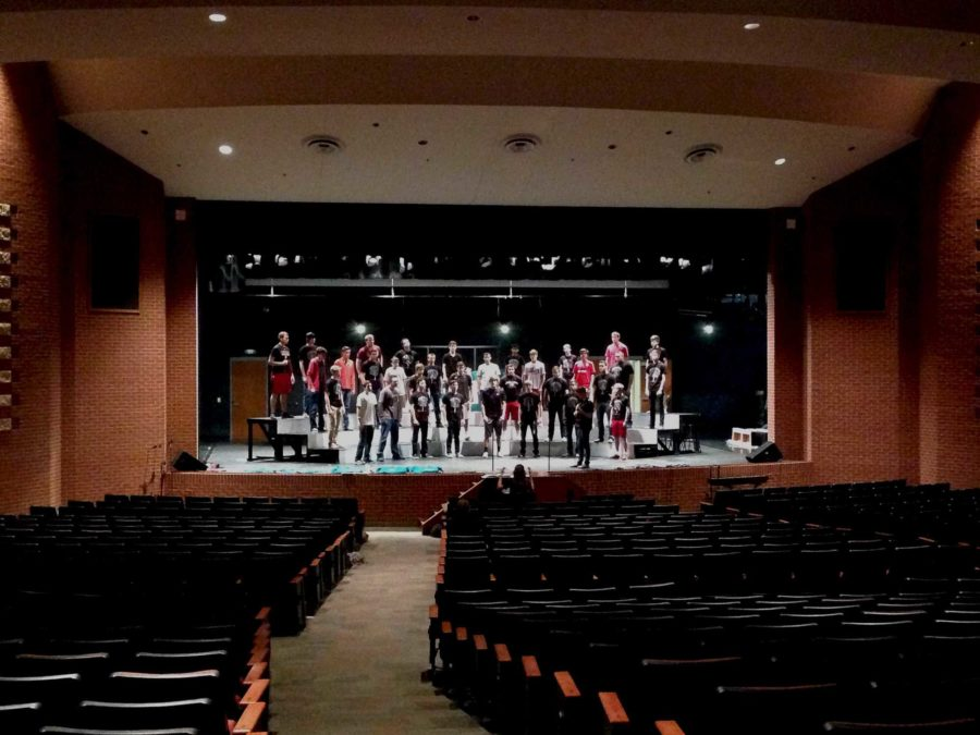 The+varsity+mens+choir+rehearses+for+the+upcoming+pop+show%2C+Madness%2C+in+class.