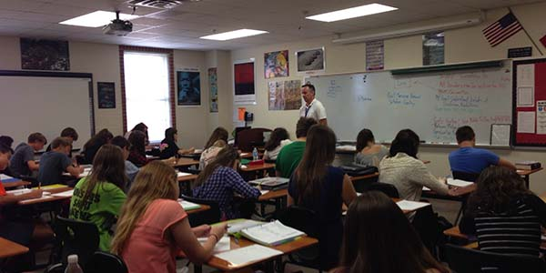 Teacher Kevin Finn instructs his students on the history of the world, even with a new AP drop policy.