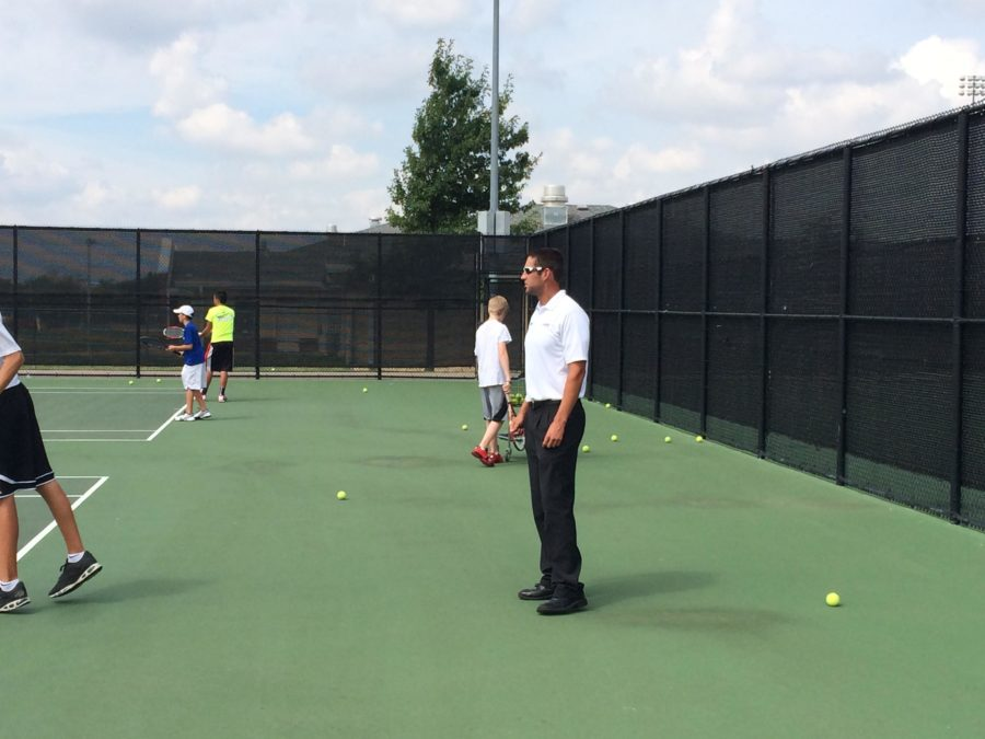 Tennis Coach Adam Cherry has led the team in one of their most successful seasons in history.