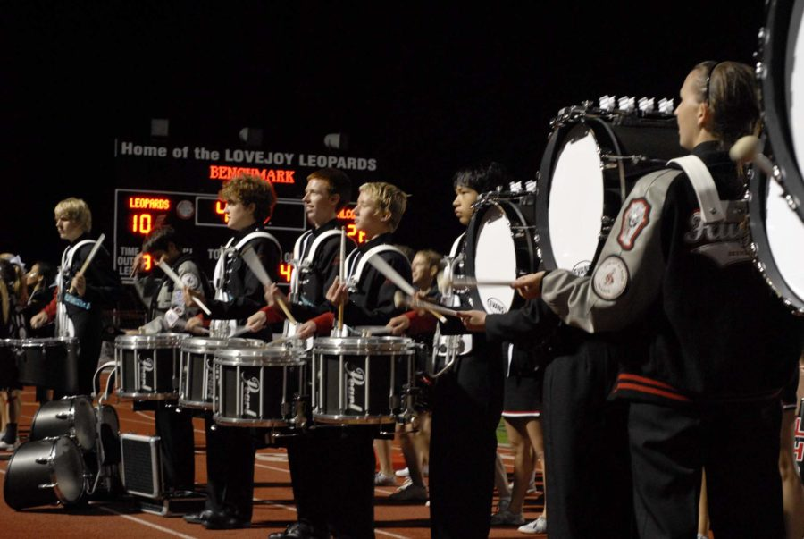 The+drum+line+plays+%22cowbell%22+to+get+the+Leopard+fans+excited+at+the+football+game+Friday.+The+Drumline+recently+competed+placing+6+out+of+12+schools.