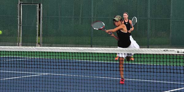Led by the #1 girls doubles team of senior Anna Dickens and junior Ariann Cnossen, the Leopard tennis team is hoping to make a long playoff run.