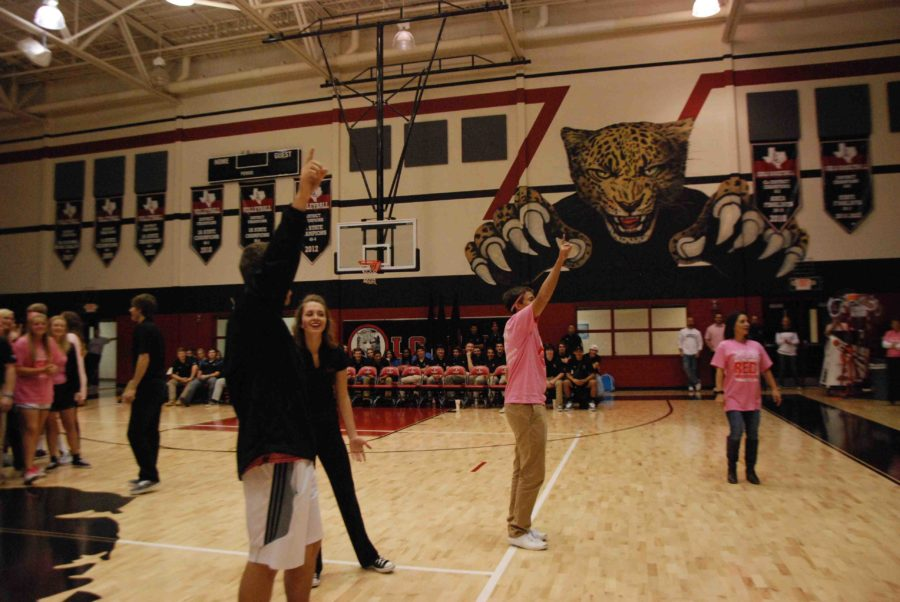 Nate Whatski, Emma Legare, and Johnny Grado try to pump up their fellow juniors at the Pink Out pep rally on Oct. 17, 2014.
