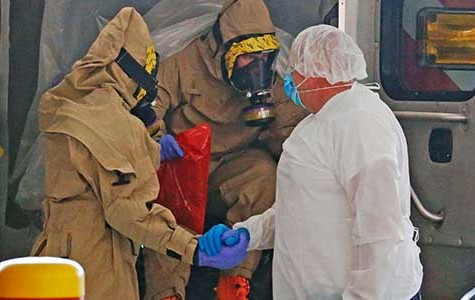 Family of Ebola victim grieves as health officials expand containment efforts