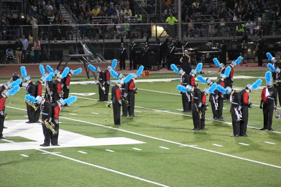 Above%2C+the+Leopard%27s+marching+band+performs+their+routine+titled+%22Blue%22+during+the+half-time+of+the+Lovejoy+vs.+Prosper+game+in+October.