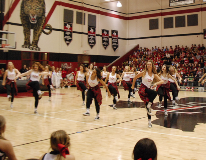 Towards+the+beginning+of+the+pep+rally%2C+junior+Emma+Legare+and+majestics+perform+their+routine.