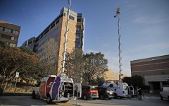 Media crews stage across from the emergency room entrance to Texas Health Presbyterian Tuesday, September 30, 2014, in Dallas. A patient at the hospital tested positive for the Ebola virus.