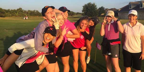 The girls golf team goofs off on Tuesday, Oct. 7 before the start of the Pink Out Tournament in support of Breast Cancer at Westridge Golf Course in McKinney. The tournament is the team's first on its fall tournament schedule.