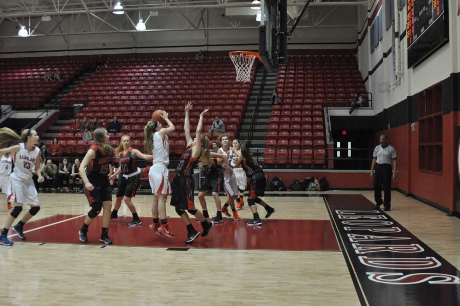 Senior Paige Eberhart goes up for a shot.