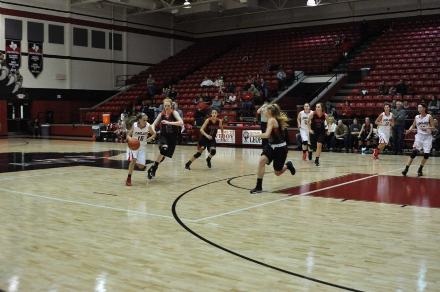 Freshman Kaylee Rikieta make s a break down the court.