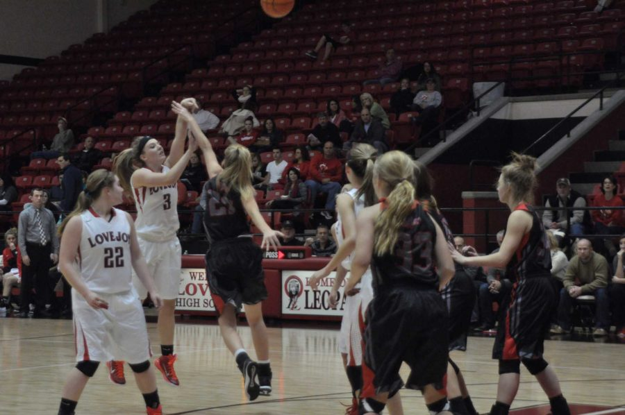 Senior Paige Eberhart takes a three pointer from the top of the dome.