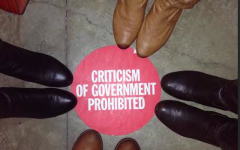 In the Newseum, an exhibit on the Berlin wall was surrounded by red dots on the floor explaining the issues (such as government interference) in Germany.