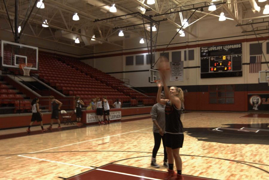 Senior Paige Eberhart practices free throws in the first practice of the year for the Leopards.
