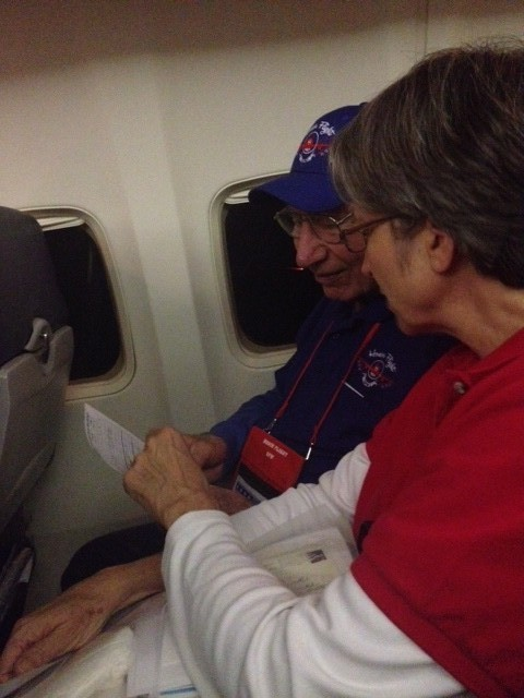 Veteran Clarence Fink and Deborah Luenser read a letter honoring his service left by passengers from the previous flight.