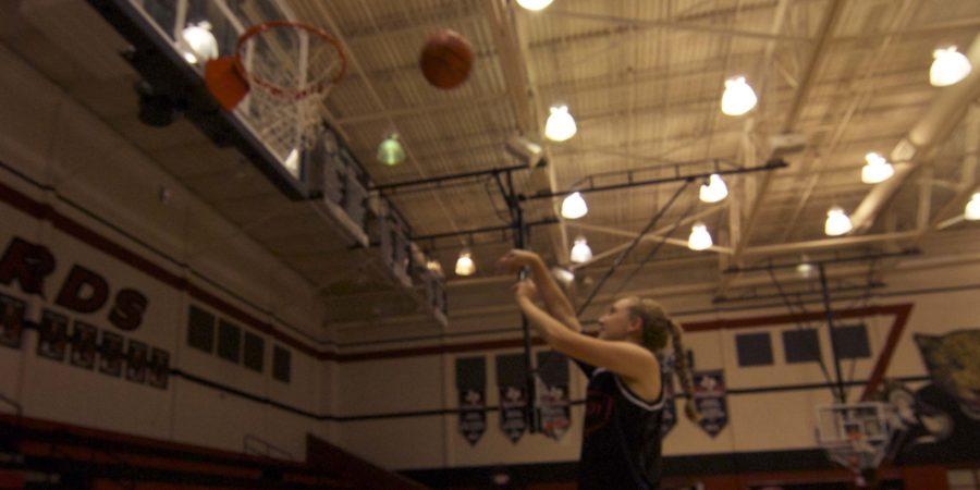 Senior Rachel Hise practices for the upcoming girls' basketball game.