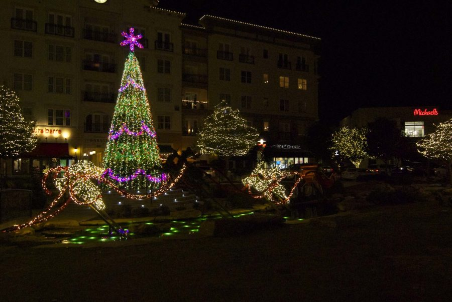 In the center of Watters Creek there are horse drawn carriages, a model sleigh, and a very large Christmas tree.