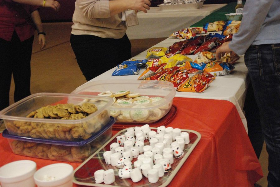 At the dance were several tables of food, including homemade cookies, chips, and hot dogs.