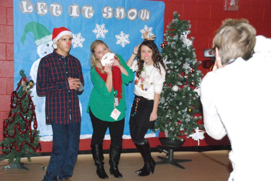 Beside the dance floor, everyone was welcome to enjoy a photo booth, set up with an assortment of holiday-related props.