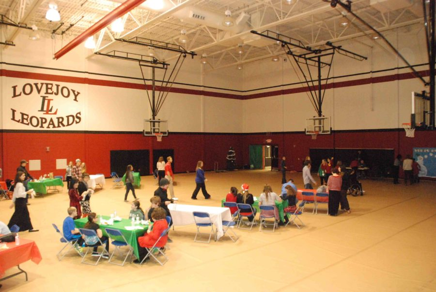 Dining tables, a dance floor, and a photo booth were all set up for the event in the auxiliary gym during all lunches on Thursday, Dec 11 2014.