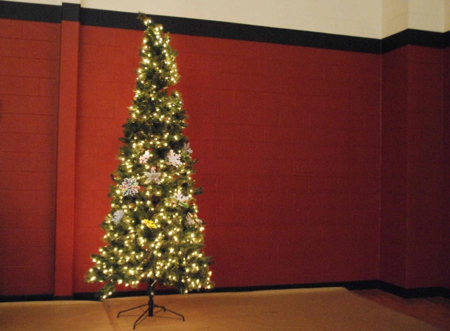 The auxiliary gym was festively decorated for the event, featuring garland and several Christmas trees.