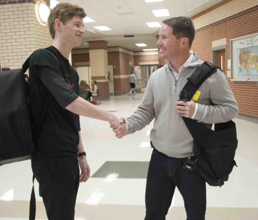 Garron Weeks shakes hands with reporter Ted Madden after his interview.