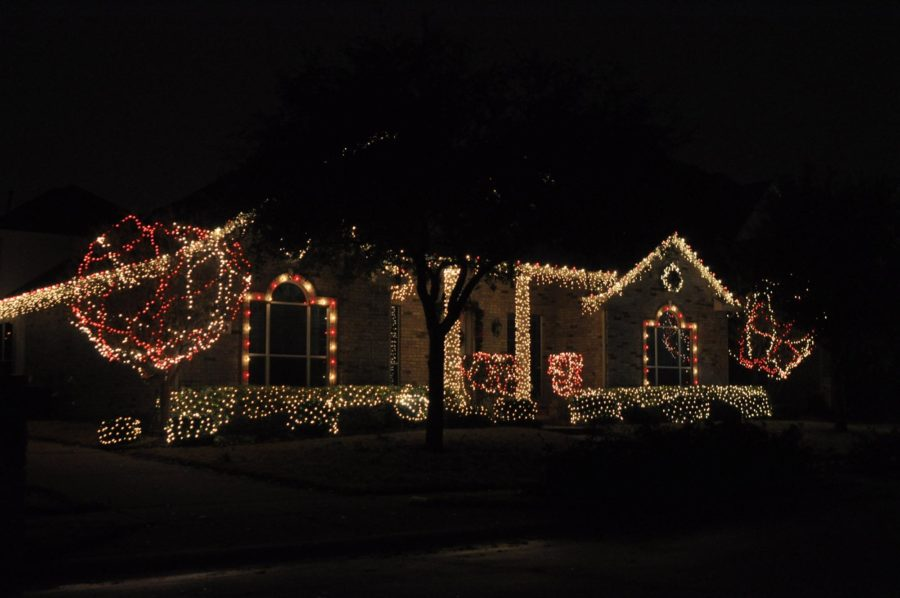 Located in Stacy Ridge this house is draped in cream and red lights