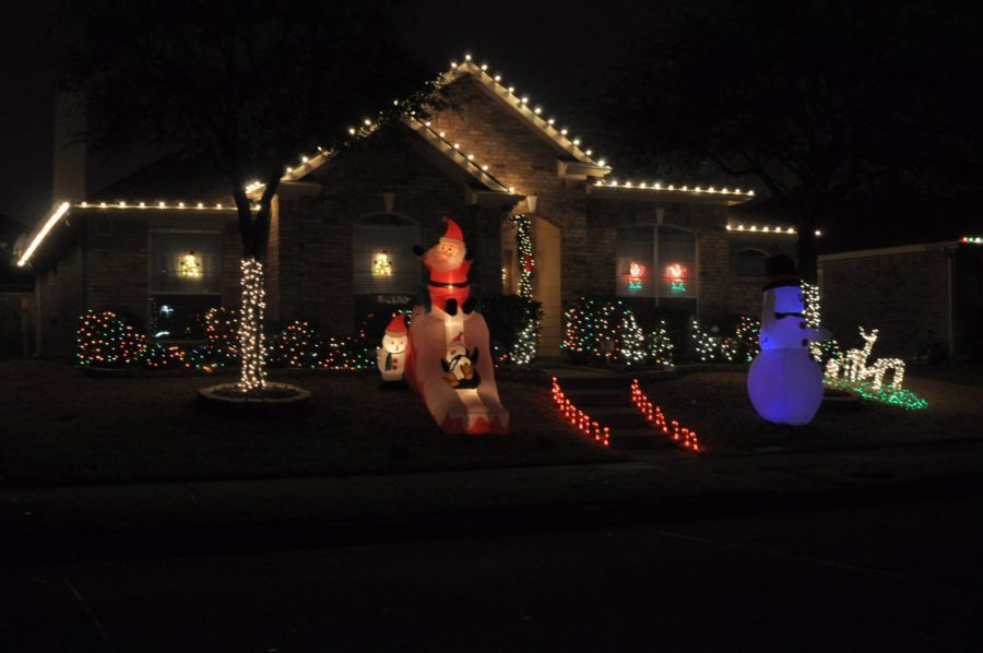 This dainty house located in Lost Creek is nicely decorated with a balance of lights and blow-up decorations