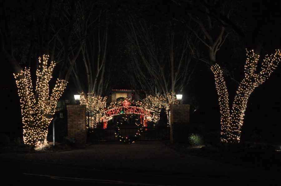 This must see house is located on Rock Ridge Rd with a front gate spelling out Merry Christmas, trees covered in lights...