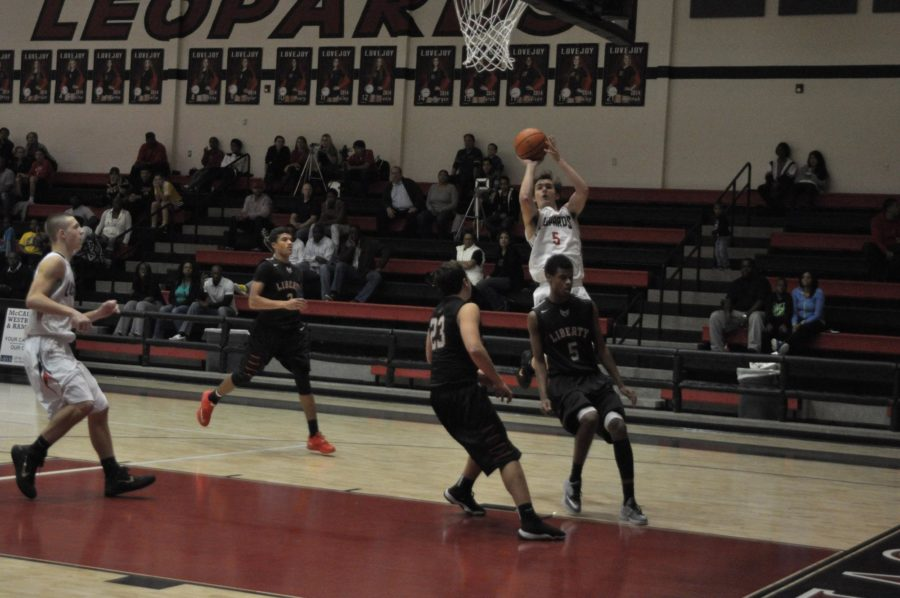 Senior Adam McDaniel jumps and shoots to score for the leopards