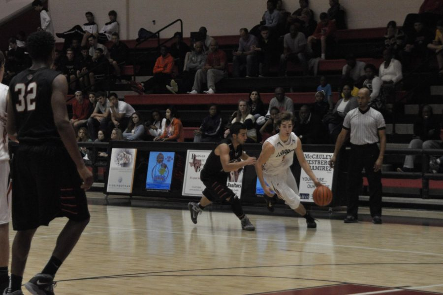 Senior Adam McDaniel brings the ball down court and cuts in towards the basket