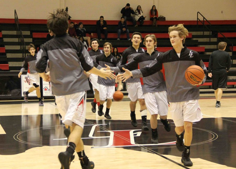 The varsity basketball teams enters the gym to play their 8:00 home game against Royce City.