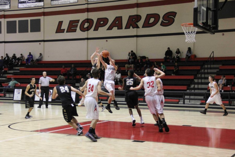 Senior Eli Traeweek, player number 11, scores a basket for Lovejoy in the end of the first half.