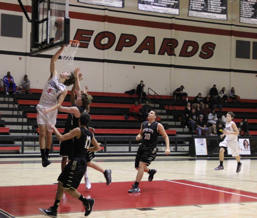 Senior Adam McDaniel scores for his team with a layup in the second quarter, one of his 17 baskets for the night.