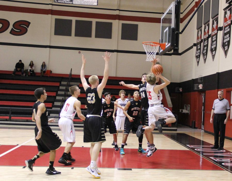 Senior Zach McManaman, player number 15, makes a layout in the third quarter.
